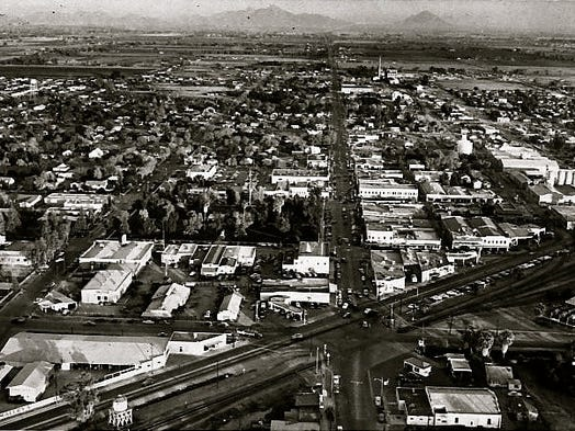 "These following West Valley businesses opened their doors before the Federal Communication Commission approved CBS's color television technology as the national standard. Before the credit card and bar codes. Before the Beatles formed and Elvis danced on the ""Ed Sullivan Show."" This photo is of downtown Glendale in 1950."