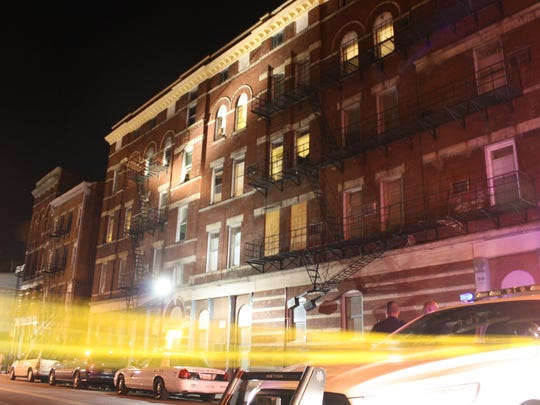 This building on 32 E. 13th St. was locked down after a man fleeing from police accidentally discharged his weapon.