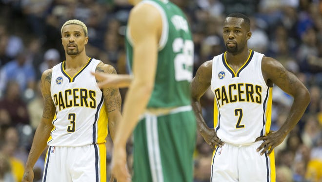 George Hill, left, and fellow Pacer Rodney Stuckey are doing better, but are still questionable to play in Saturday's home game against the Milwaukee Bucks.
