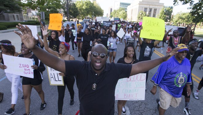 Rev. Devanta Scruggs takes part in a rally and demonstration in support of the Black Lives Matter movement, Indianapolis, Saturday, July 9, 2016.