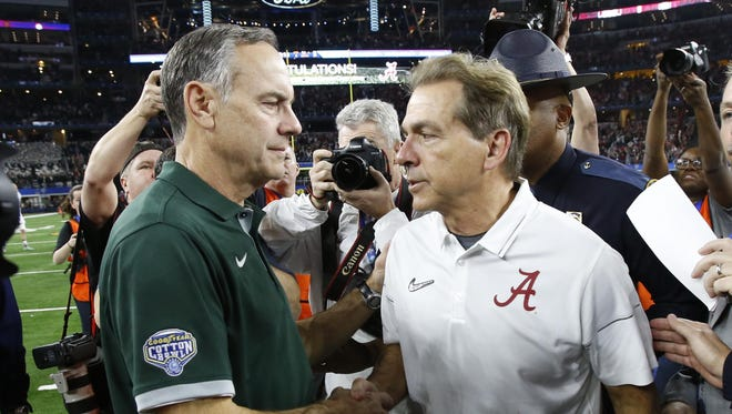 Michigan State Spartans head coach Mark Dantonio (left) and Alabama Crimson Tide head coach Nick Saban (right) shake hands after the 2015 CFP semifinal at the Cotton Bowl at AT&T Stadium.