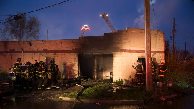 Indianapolis Fire Department personnel work on mopping up an earlier fire that caused a partial collapse of a building in the 1500 block of Blaine Avenue, on the city's near southwest side, Indianapolis, Tuesday, April 11, 2017. No injuries were reported.