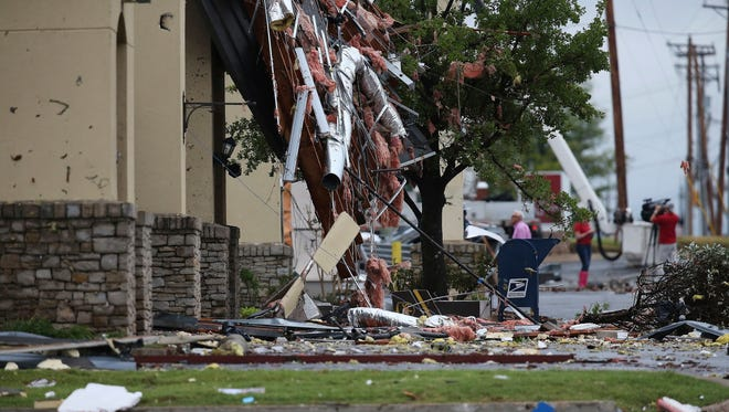Damage left by a storm in Tulsa, Okla is shown on Sunday, Aug. 6, 2017. A tornado struck near midtown Tulsa causing power outages and damage to businesses.