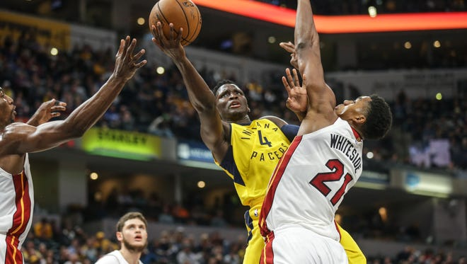Indiana Pacers guard Victor Oladipo (4) drives past the Miami Heat center Hassan Whiteside (21) for a layup during a game at Bankers Fieldhouse on Wednesday, Jan. 10, 2018.
