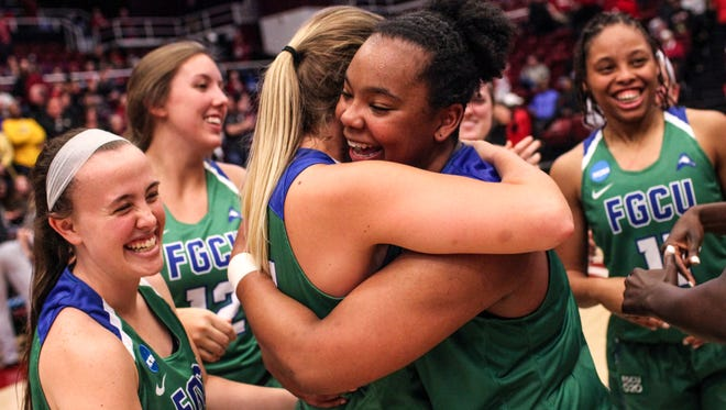 FGCU's Taylor Gradinjan (24) and FGCU's China Dow (22) hug after defeating Missouri 80-70 in a first round NCAA tournament game at Maples Pavilion in Stanford, Calif., Saturday, March 17, 2018.