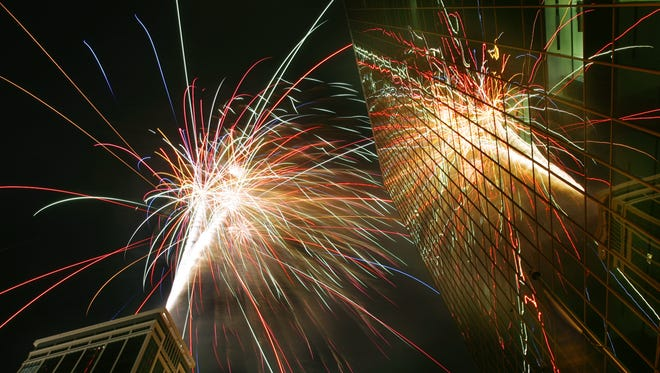 Fireworks explode of the Regions Bank and are reflected in One Market Square building,right, during the Regions Bank Freedom Blast Wednesday night downtown Indianapolis in 2007.
