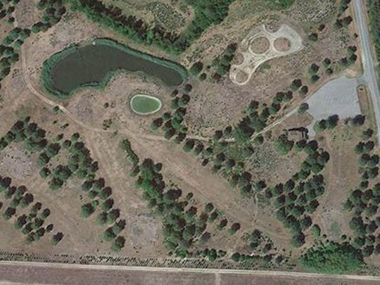 This aerial photo shows the former Woodland Park Golf Course, acquired by Sussex County for placement of material that was dredged from the Nanticoke River, with the former Woodland School House visible to the right middle of the photo. With dredging complete, the county is moving forward with its plan for a low-impact park at the site and is seeking public input about what should be done with the historic school at the site.