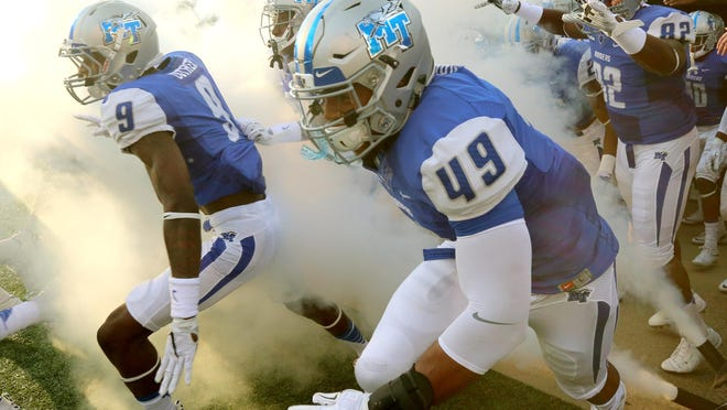 MTSU players take the field for last Saturday's game in Murfreesboro against Jackson State.