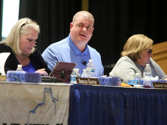 Christina School District board member John Young  speaks on the 'sanctuary' policy he has proposed at a board meeting Tuesday. Board members SShirley Saffer (left) and Meg Mason sit beside him.