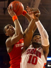 Syracuse's Andrew White III, left, has showed renewed vigor on the boards. He's averaging 5.2 rebounds in ACC play, slightly down from his 5.9 average last year at Nebraska.