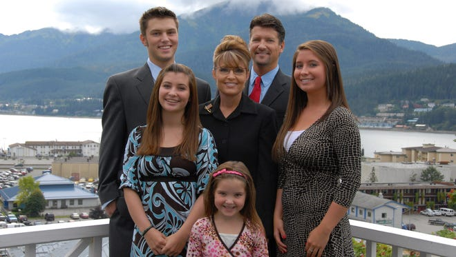 Sarah Palin, governor of Alaska, center, poses for a photo with daughters, Piper, center front, Willow, left, Bristol, right, son, Track, back left, and husband Todd, back right, in Juneau, Alaska, U.S., in 2007.