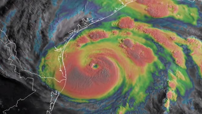An infrared satellite image shows Hurricane Harvey spinning off the Texas coast on August 25, 2017.