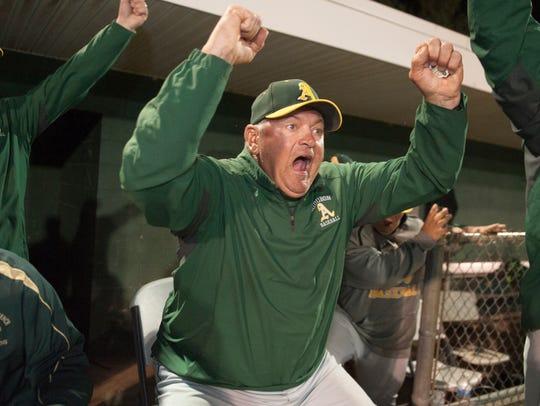 Audubon High School baseball coach Rich Horan celebrates