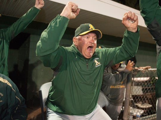 Audubon High School baseball coach Rich Horan celebrates after Audubon defeated West Deptford 11-3 at Union Field in West Deptford on Thursday night.  The win marked Horan's 500th career victory.  05.11.17