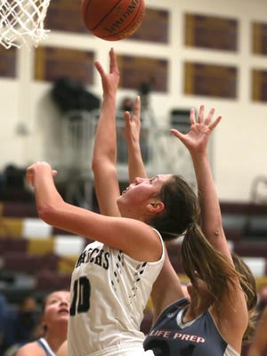 TMP junior Emilee Lane puts up a shot inside on Thursday against Life Prep in the Gerald Mitchell Hays City Shootout.