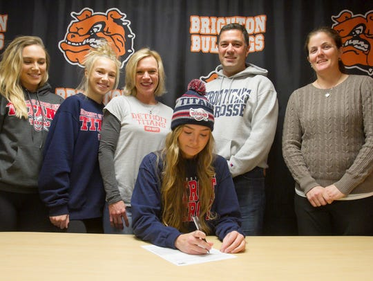 Allison Falk signs her letter of intent Wednesday,
