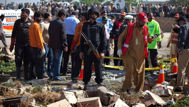 Police cordon off the area of a blast in Islamabad, Pakistan, Wednesday.