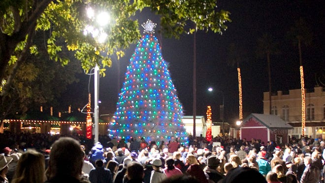 The parade of lights and lighting of the tumbleweed Christmas tree in Chandler always draws a crowd.
