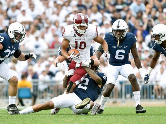 Temple's Marshall Ellick is brought down by Penn State's Brandon Smith (behind) and Marcus Allen in the first half of an NCAA Division I college football game Saturday, Sept. 17, 2016, at Penn State. Penn State defeated Temple 34-27, and celebrated the 50th anniversary of former head coach Joe Paterno's first game by honoring members of the 1966 football team and showing video tributes on the scoreboard.