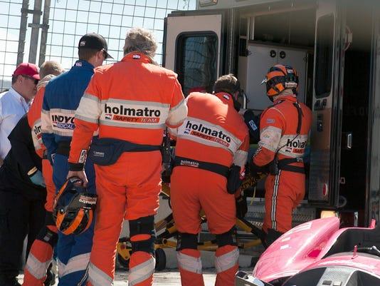 10-6-13-dario-franchitti-ambulance