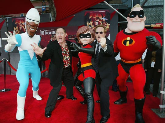 Pixar's John Lasseter (left) and director Brad Bird arrive at the premiere of Disney's 'The Incredibles' on Oct. 24, 2004 at the El Capitan Theatre, in Los Angeles.