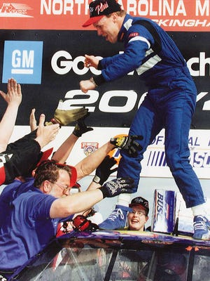 Kenseth and the Reiser Enterprises crew celebrate  his first Busch Series victory,  the GM Goodwrench Service Plus 200 on Feb. 21, 1998,  at the North Carolina Speedway in Rockingham, N.C.