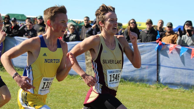 Silver Lake's Kyler Kaniper, right, finished second in the Class 3A state cross country meet last fall, leading the Eagles to a second-place team finish. A four-sport athlete, Kaniper was named the Topeka Shawnee County overall male athlete of the year.