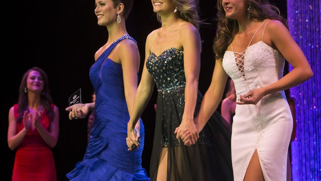 Miss New Berlin Rosalie Smith, left, wins the Thursday's talent award and Miss Southern Wisconsin Raquel Bruening wins the lifestyle and fitness award while walking with Miss Wisconsin Raeanna Johnson during the Miss Wisconsin preliminary competition June 18 at the Alberta Kimball Auditorium.