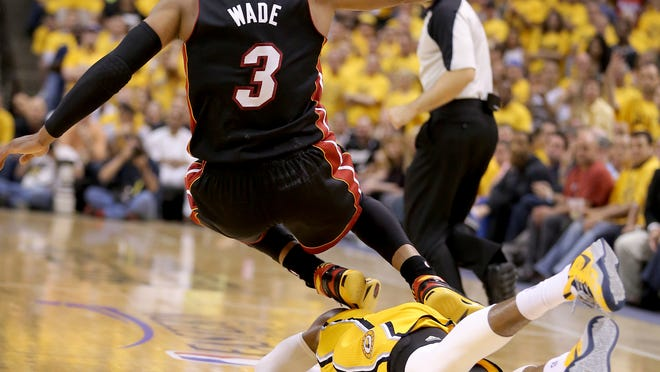 Pacers Paul George is kicked in the head by Miami Heats Dwayne Wade in the second half of action. Indiana Pacers play the Miami Heat in Game 2 of the NBA Eastern Conference Finals Tuesday, May 20, 2014, evening at Bankers Life Fieldhouse. The Pacers lost to the Heat 87-83.