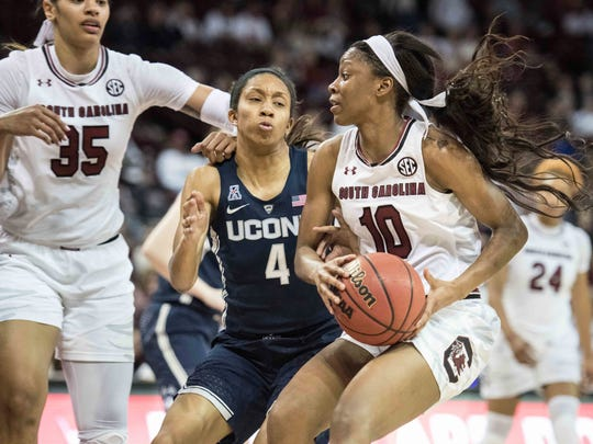 South Carolina guard Bianca Jackson (10) drives to the hoop against Connecticut guard Mikayla Coombs (4) during the second half of an NCAA college basketball game Thursday, Feb. 1, 2018, in Columbia, S.C. Jackson scored a career-high 20 points in South Carolina's 83-58 loss to the Huskies.