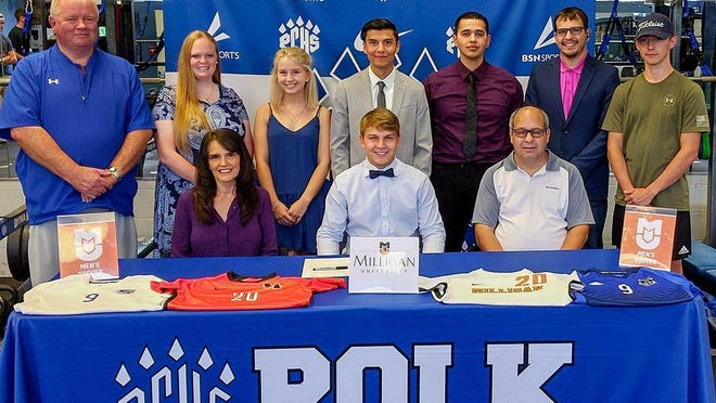 Flanked by his parents, Angie and Mark Edwards, Polk County graduate Isaac Edwards made a dream come true last week in signing with Milligan College. Also present, back row from left, were: Polk County athletic director Rex Wells, Caroline Edwards, Allie Thompson, PCHS head coach Josh Trejo, PCHS assistant coach Rogelio Najera, Jared Edwards and Ethan Edwards.