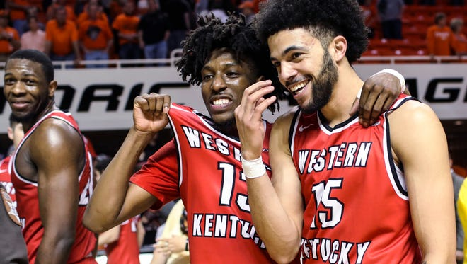 Western Kentucky guards Taveion Hollingsworth (13) and Darius Thompson celebrate after the team's win over Oklahoma State during an NCAA college basketball game in the NIT quarterfinals Wednesday, March 21, 2018, in Stillwater, Okla. (Austin Anthony/Daily News via AP)