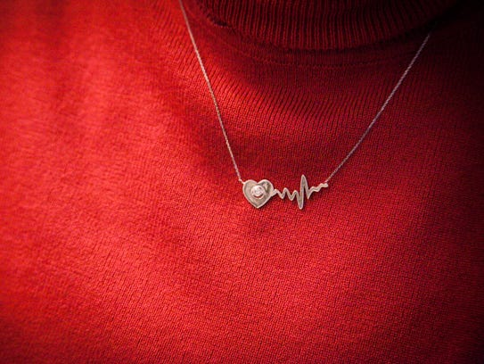 A close up of Susan Middleton's necklace she received