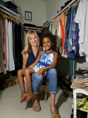 Hollie Smith-Schmid relaxes with her daughter Addison in her Fort Myers home recently.