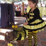 Dressed as bumblebees, Sofia Stanley and her dog, Atlas, buzzed past the judges table during the costume contest for a past Barktoberfest.