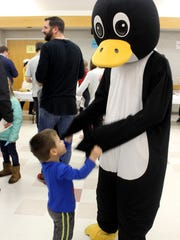 The Recreation Department's mascot Peri the Penguin was on hand for the festivities as well. Here he visits with Jake Torres, 3,