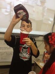 Sixth-grader Preston Ruedinger shows students how to