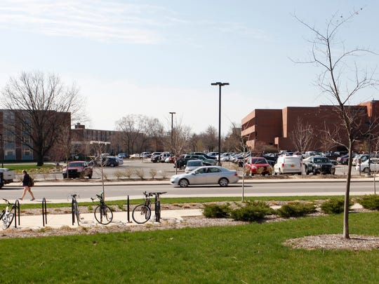 Cars, bikes and pedestrians are visible around the