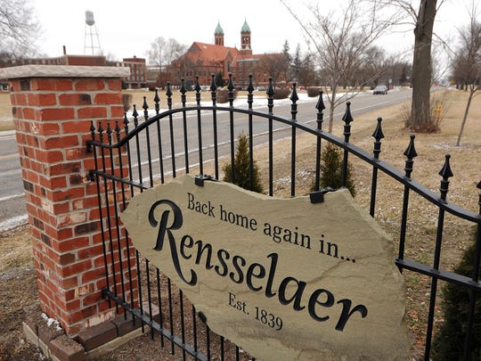 Saint Joseph College looms in the background of the welcome to Rensselaer sign, Wednesday, January 15, 2014, in Rensselaer.