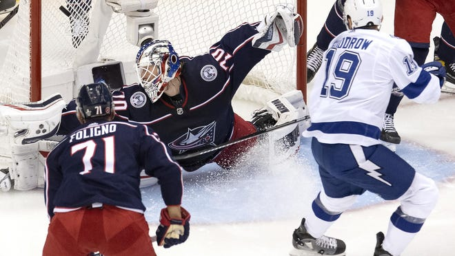 Tampa Bay Lightning centre Barclay Goodrow (19) scores on Columbus Blue Jackets goaltender Joonas Korpisalo (70) as Jackets left wing Nick Foligno (71) looks on during second period of NHL Eastern Conference Stanley Cup first round playoff hockey action in Toronto on Monday, August 17, 2020.