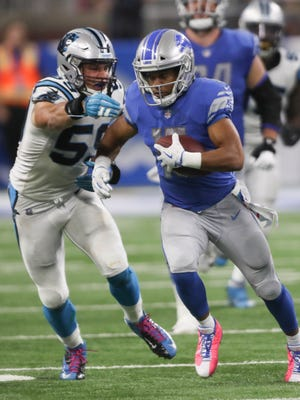 Golden Tate is tackled by Luke Kuechly in the fourth quarter of the Lions' 27-24 loss to the Panthers at Ford Field on Oct. 8.