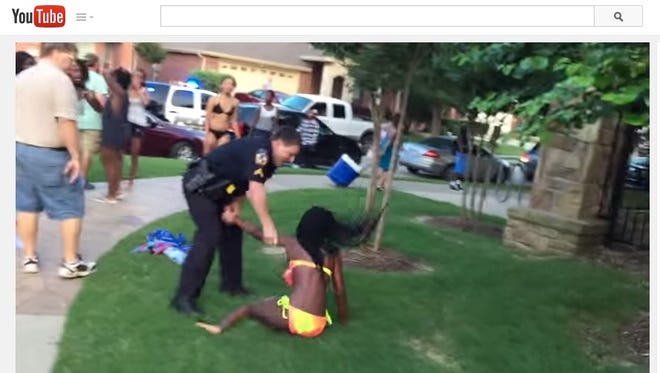 A seven-minute YouTube clip showed the now-suspended officer using profanity and aggressively throwing a 15-year-old girl in a bathing suit to the ground, face-down. He then appeared to pin her down with his knees.