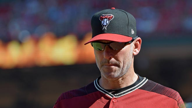 Jul 30, 2017: Arizona Diamondbacks manager Torey Lovullo (17) walks back to the dugout during the ninth inning against the St. Louis Cardinals at Busch Stadium.