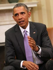 """We're not losing anything through these talks,"""" President Barack Obama said of negotiations with Iran."""