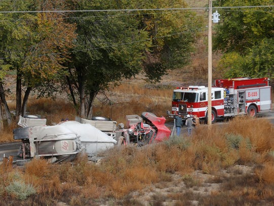 Law enforcement and emergency crews investigate a truck rollover near Navajo Service Road 367 in Nenahnezad on Thursday morning.