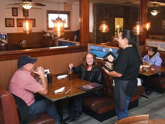Server Karina Kinsel takes a lunch order from Johnny and Cyndi Moskal on Monday at Porter's Restaurant in Farmington.