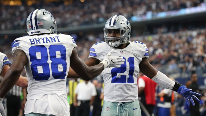 Nov 20, 2016: Dallas Cowboys receiver Dez Bryant (88) celebrates his third quarter touchdown with runnign back Ezekiel Elliott (21) against the Baltimore Ravens at AT&T Stadium.