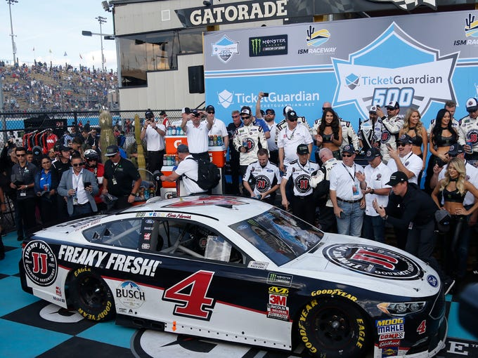 Kevin Harvick celebrates winning the Ticket Guardian