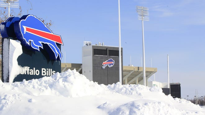 Snow covers  a sign at Ralph Wilson Stadium,  home of the Buffalo Bills in Orchard Park, N.Y., on Wednesday, Nov. 19, 2014.