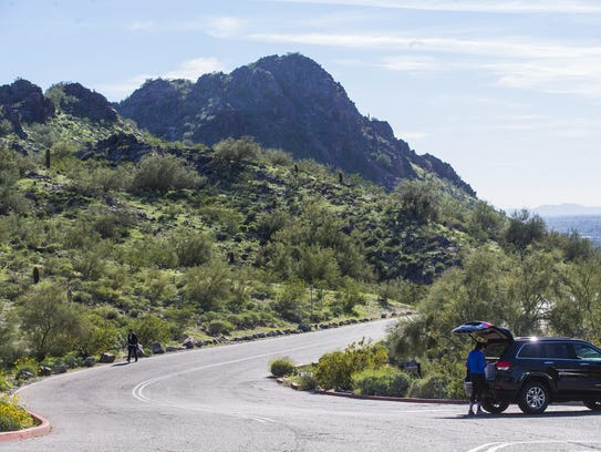 People take the road leading up to Piestewa Peak using